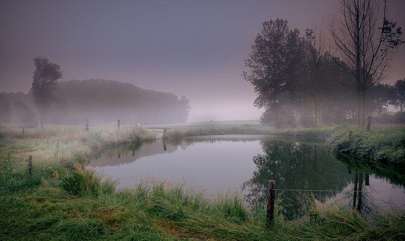Sunrise mist fog on the water van Wim van D
