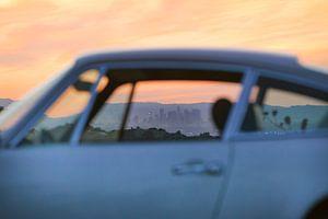 LA skyline through the window of a 911
