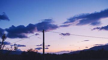 Italiaanse zonsondergang van Tom Rijpert
