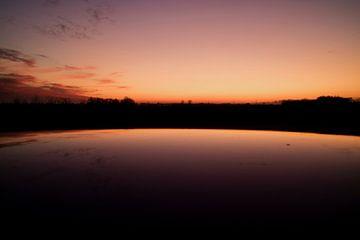 Nederlandse zonsondergang met weerspiegeling van Coco Everts
