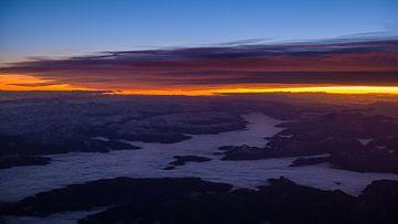 Zonsopgang boven de Alpen van Denis Feiner