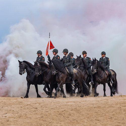 Paarden door de rook, op het schevingse strand van