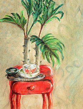 Theekopje op een rood tafeltje. van Ineke de Rijk