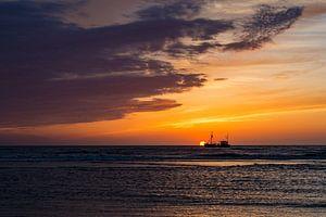 zonsondergang met schip