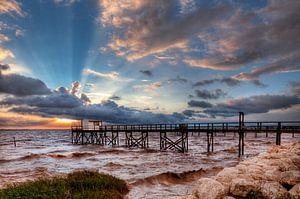 Franse visserhuisje bij zonsondergang van
