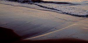 Zonsondergang in het zand van