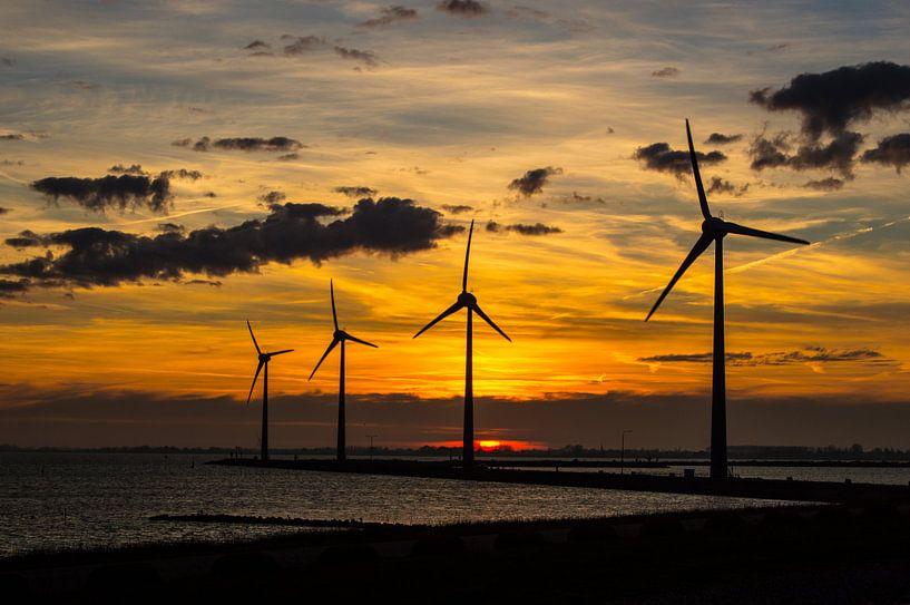 Winter sky with windmills van Brian Morgan