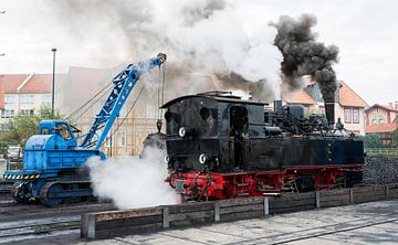 crane loading coal into steam loc