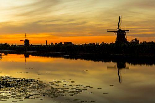 Molens bij zonsondergang in Kinderdijk