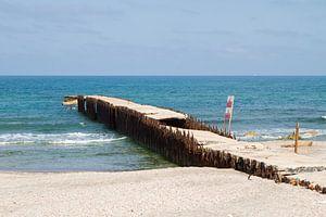 Oude pier in zee van