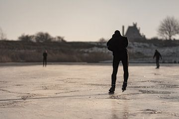 Schaatsers op het ijs