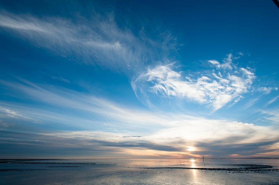 zonsondergang op het wad van Geertjan Plooijer