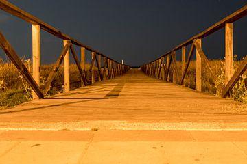 Nachtschot vanaf een steiger op het strand van Conil de la Frontera van Gottfried Carls