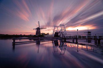 Paarse zonsondergang Kinderdijk van Rob Bout