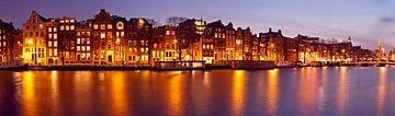 Panorama van Amsterdam met de Munttoren in Nederland bij zonsondergang sur Nisangha Masselink
