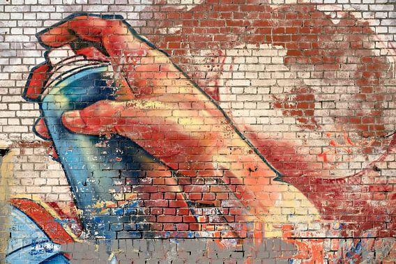 Graffiti afbeelding van een hand met verfspuitbus