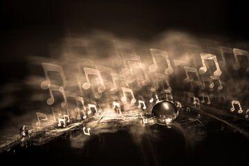 Goutte d'eau sur une peluche avec bokeh sous forme de note de musique