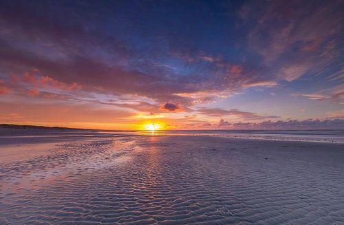 Landschap, zonsondergang op het strand van