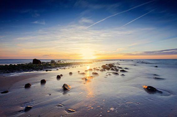 zonsondergang langs de Nederlandse kust