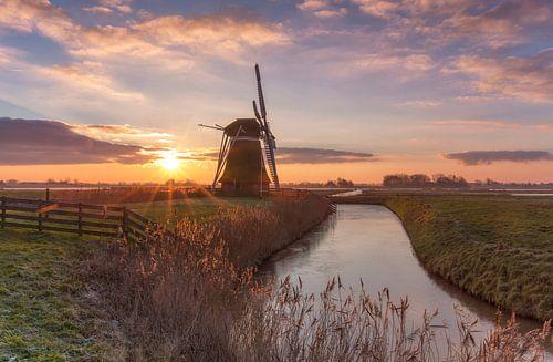 Landschap, molen bij zonsopkomst van