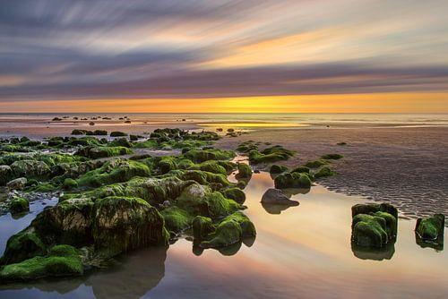 Zonsondergang bij de kust van Normandie