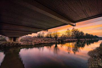 Zonsondergang onder de brug van Marc-Sven Kirsch