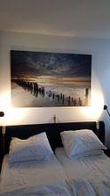 Klantfoto: Laatste licht op het wad van Ron Buist, op canvas