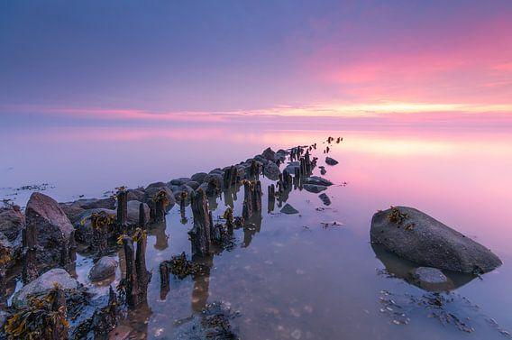Zonsondergang boven het wad
