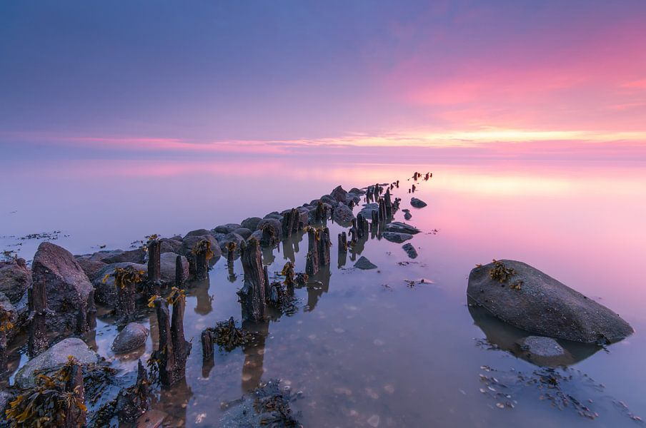 Zonsondergang boven het wad van Menno Bakker