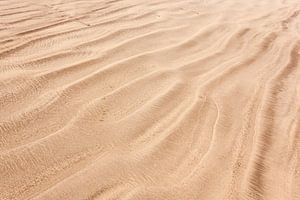 Zand tussen je tenen van