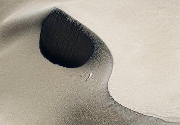 Yin yang in zand van