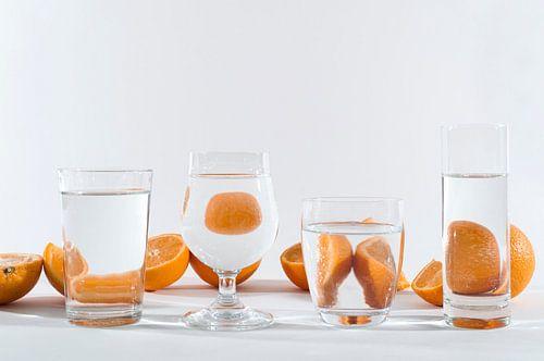 Sinaasappelen door het glas