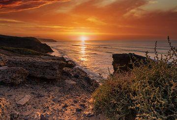 Kleurrijke zonsondergang aan de kust van Christian Klös