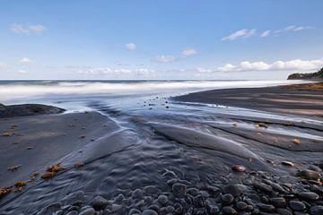 Dark beach with sand ribs van