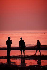 Silhouetten met zonsondergang