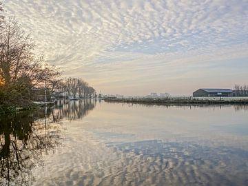 landschap met waterspiegeling van Dirk van Egmond