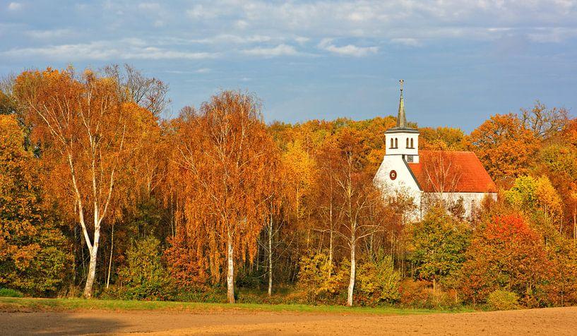 Village church surrounded by autumnal colours van Gisela Scheffbuch
