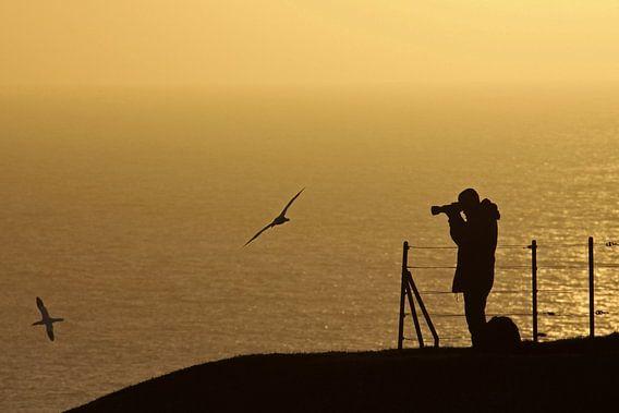 fotograaf tijdens zonsondergang