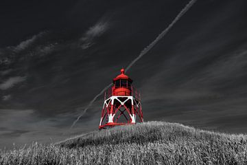 De vuurtoren van het Friese stadje Stavoren in het avondlicht van Harrie Muis