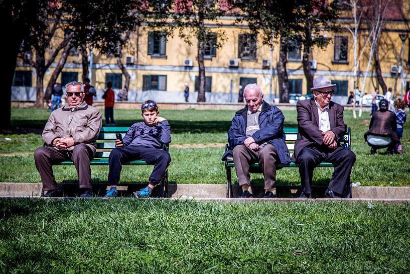 Sitting on a bank van Julian Buijzen