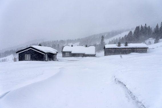 Hutten in sneeuwval