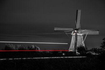 Die Windmühlen von Kinderdijk in den Abend von John Ouwens