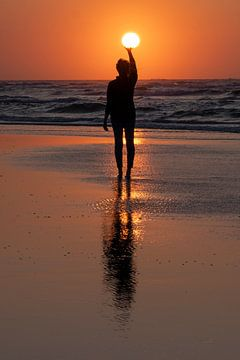 Zonsondergang in de handen van een vrouw van Wad of Wonders