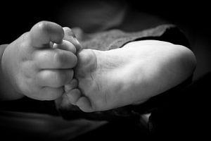 Kleine handjes en voetjes van