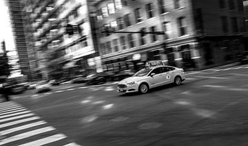 Amerikaanse taxi op de kruising van Derrick Kazemier