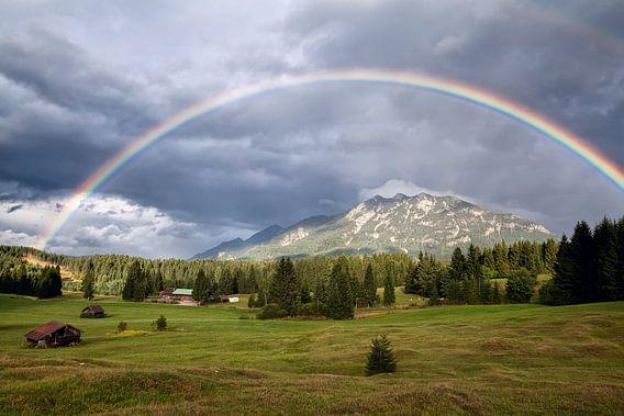 Big rainbow over the Alpine meadows, Bavaria.