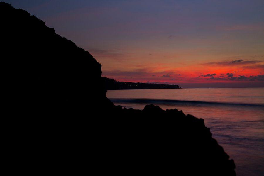 Ondergaande zon op Dreamland Beach Bali
