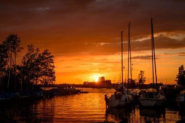 sunset in the harbor of de veenhoop in holland