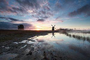 charming sunrise behind Dutch windmill