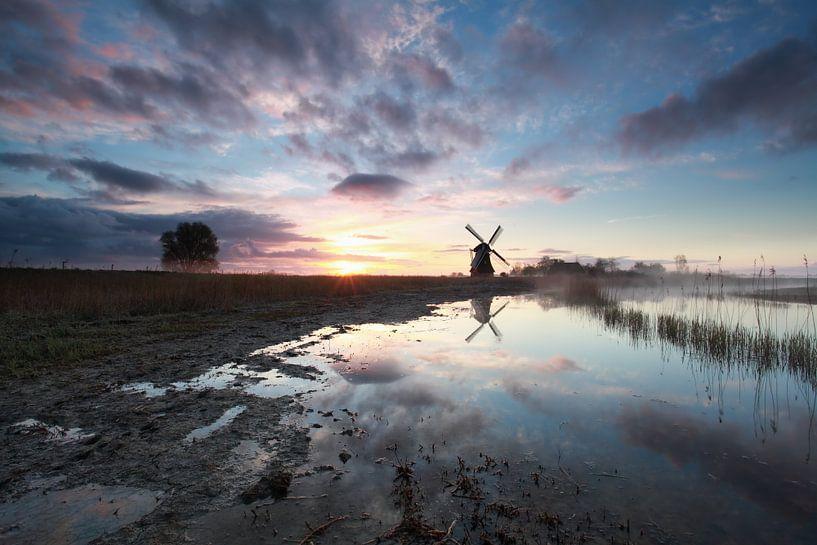charming sunrise behind Dutch windmill van Olha Rohulya